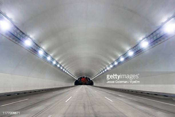 view of illuminated tunnel - jesse coleman stock pictures, royalty-free photos & images