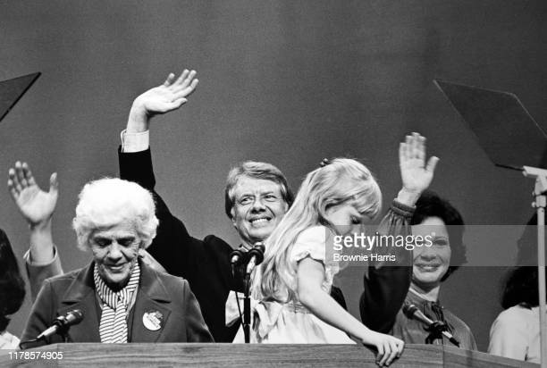 View of in rear American politician Jimmy Carter and his wife Rosalynn Carter waving at the Democratic National Convention New York New York July 15...