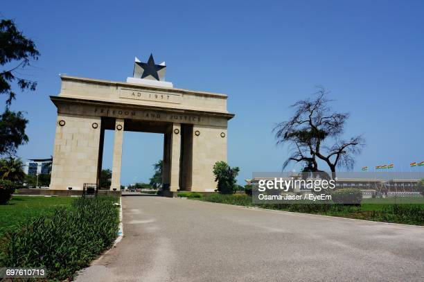 view of independence arch against clear blue sky - ghana independence stock pictures, royalty-free photos & images
