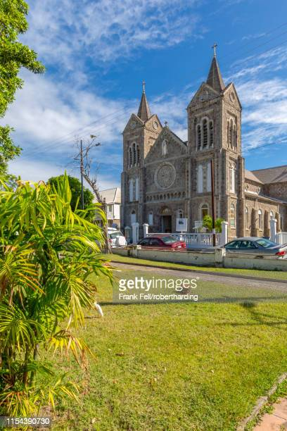 view of independence square and immaculate conception catholic co-cathedral, basseterre, st. kitts and nevis, west indies, caribbean, central america - st. kitts stock photos and pictures