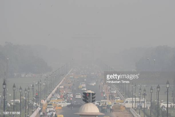 A view of India Gate seen engulfed with a thick layer of smog from Rashtrapati Bhawan on November 13 2018 in New Delhi India Pollution levels in...