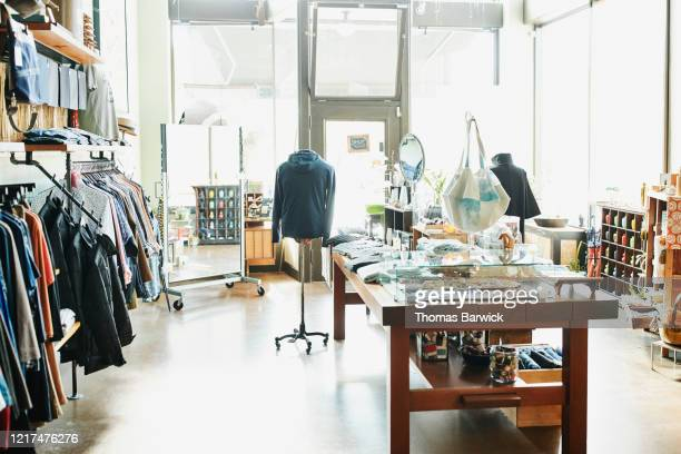 view of interior of clothing boutique - small business stock pictures, royalty-free photos & images