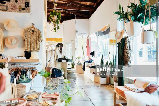 view of interior of clothing boutique - boutique stock pictures, royalty-free photos & images
