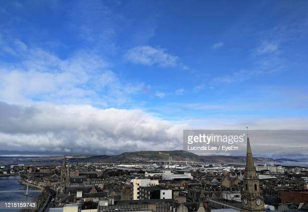 view of inverness rooftops against sky - lucinda lee stock pictures, royalty-free photos & images