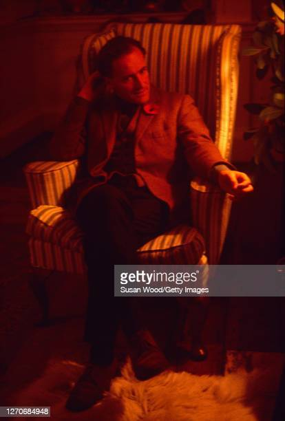 View of Irish author and conservationist Desmond Guinness as he sits in an armchair at his home Leixlip Castle Leixlip County Kildare Ireland 1968