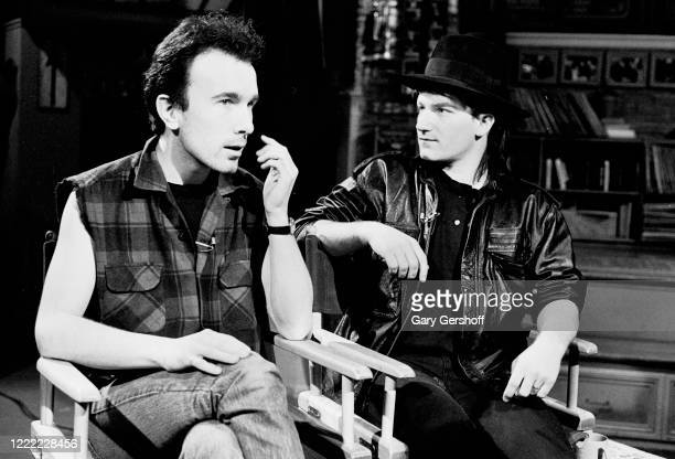 View of Irish Rock musicians the Edge and Bono , both of the group U2, during an interview at MTV Studios, New York, New York, April 20, 1983.
