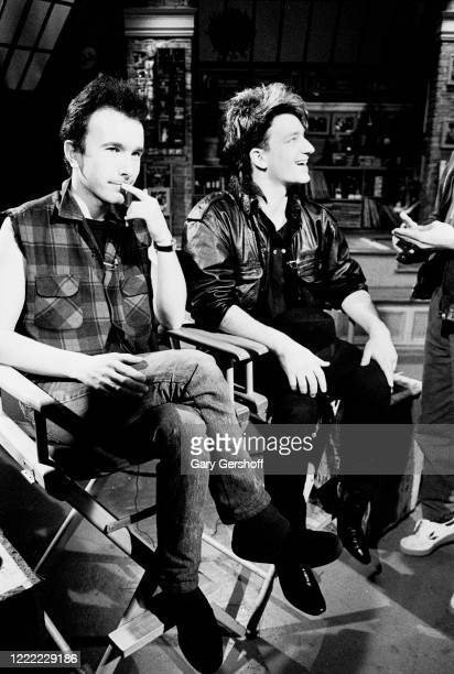 View of Irish Rock musicians the Edge and Bono both of the group U2 during an interview at MTV Studios New York New York April 20 1983