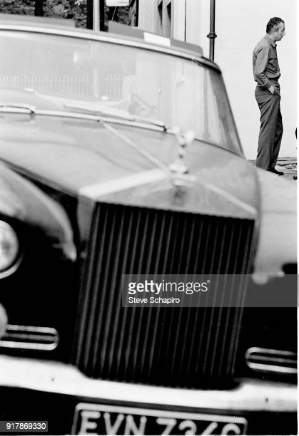View of Italian film director Michelangelo Antonioni on the set of his film 'BlowUp' London England 1965 Visible in the foreground is a Rolls Royce...