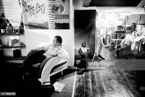 View of Italian film director Michelangelo Antonioni on the set of his film 'BlowUp' London England 1965 The others are unidentified