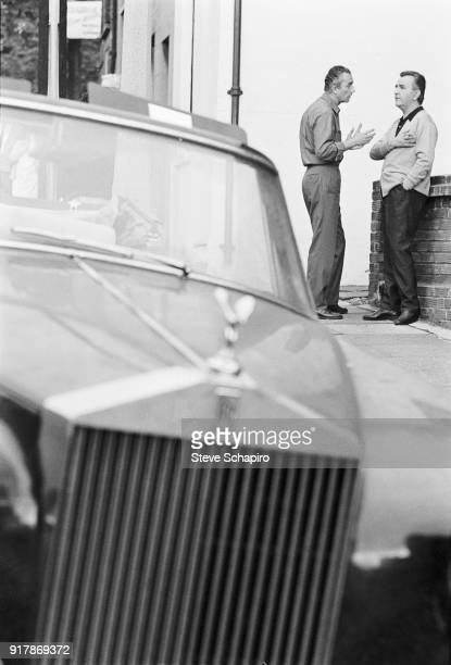 View of Italian film director Michelangelo Antonioni speaks with an unidentified man on the set of his film 'BlowUp' London England 1965 Visible in...