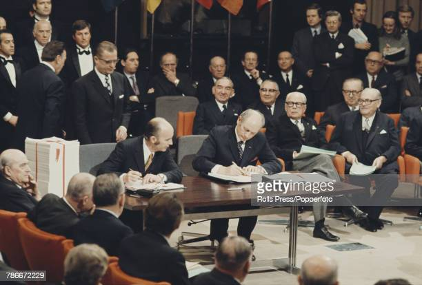 View of Jack Lynch Prime Minister of Ireland signing the accession treaty for Ireland to join the European Economic Community at the Egmont Palace in...