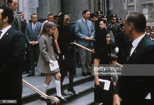 View of Jackie Kennedy and John F Kennedy Jr followed by her sister Lee Radziwill and daughter Caroline Kennedy as they descend the steps of Saint...