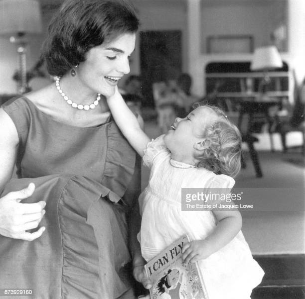 View of Jacqueline Kennedy and her daughter Caroline as they play together Hyannis Port Massachusetts August 1960 The photo was taken during a...
