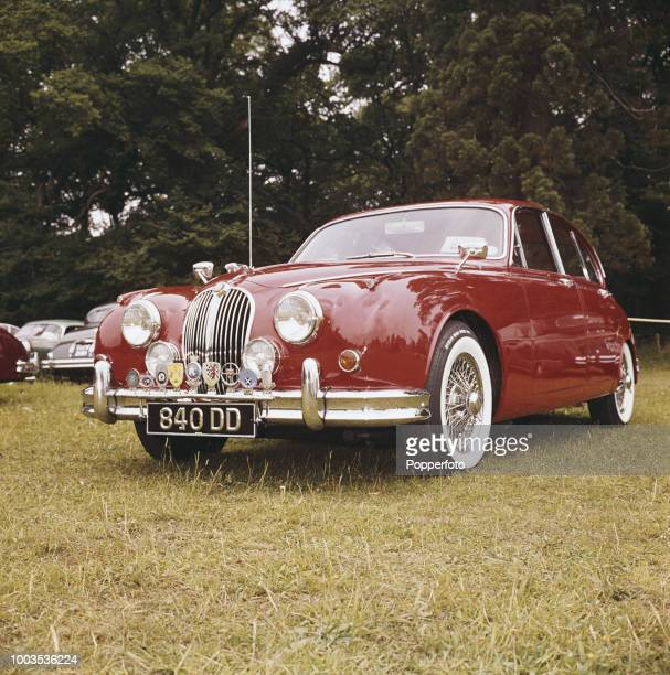 View of Jaguar Mark 2 car with the registration number 840 DD pictured in a field at a Jaguar owners club meeting and convention in September 1961