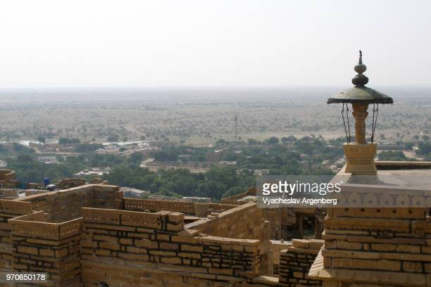 a view of jaisalmer and sandy expanse of thar desert from jaisalmer fort, rajasthan, india - argenberg stock pictures, royalty-free photos & images