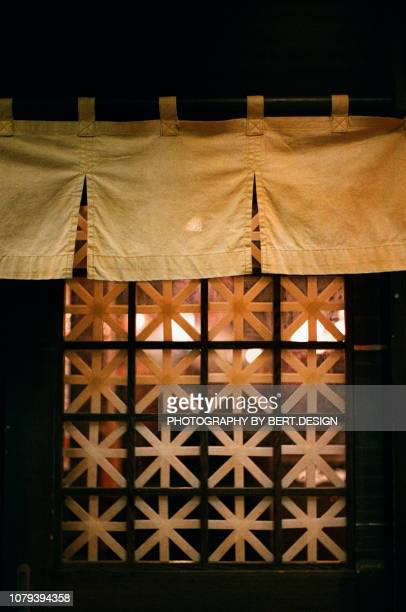 view of japanese restaurant curtain on door in tokyo - のれん ストックフォトと画像