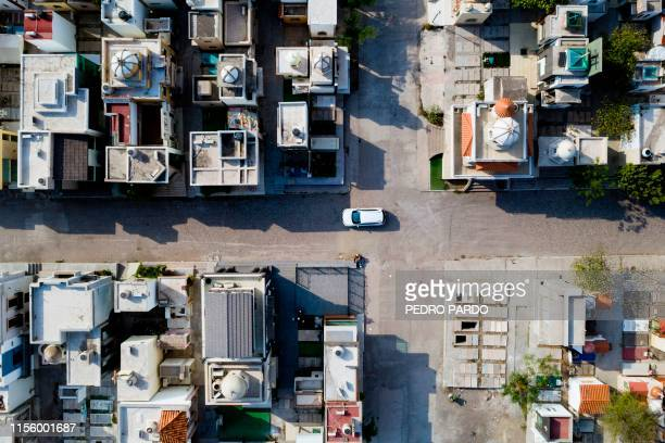 TOPSHOT View of Jardines del Humaya cemetery known due to its mausoleums where drug traffickers are buried that count with luxuries and services such...