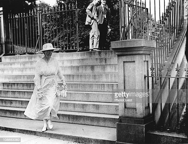 View of Jeanette Rankin of Colorado, the first female member of the United States Congress, as she walks on the streets in Washington, DC, early...