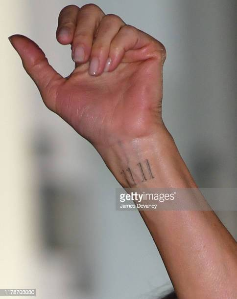 View of Jennifer Aniston's tattoo on her wrist at Apple's The Morning Show premiere at Lincoln Center on October 28 2019 in New York City