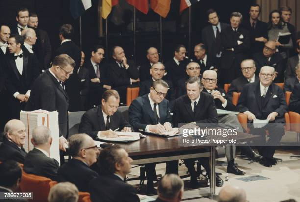 View of Jens Otto Krag Prime Minister of Denmark signing the accession treaty for Denmark to join the European Economic Community at the Egmont...