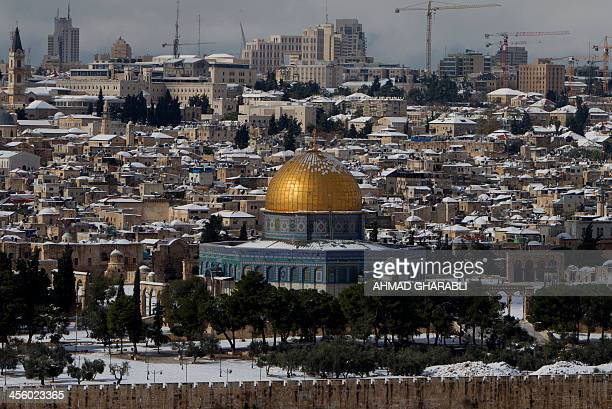 A view of Jerusalem's Old City following a snowstorm as seen from the Mount of Olives on December 13 2013 The hilltop city of Jerusalem was paralysed...