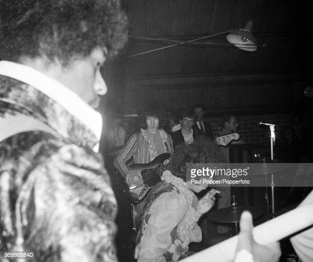 View of Jimi Hendrix performing live on stage with the Jimi Hendrix Experience at the Barbeque 67 music festival at the Tulip Bulb Auction Hall in...