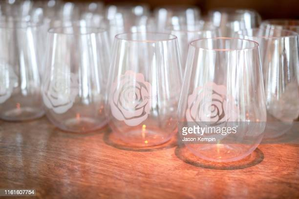 A view of JNSQ branded glasses as JNSQ Serves Its Rosé Cru And Sauvignon Blanc At The Miami Swim Week Influencer Brunch Hosted By Natasha Oakley And...