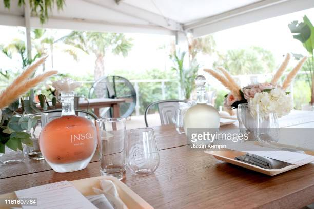 A view of JNSQ wines on display as JNSQ Serves Its Rosé Cru And Sauvignon Blanc At The Miami Swim Week Influencer Brunch Hosted By Natasha Oakley And...
