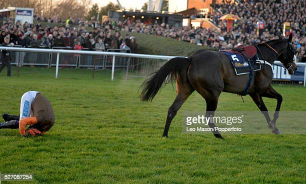 View of jockey Sam Waley-Cohen falling from pre-race favourite Long Run at the last fence in the William Hill King George VI Chase during the William...