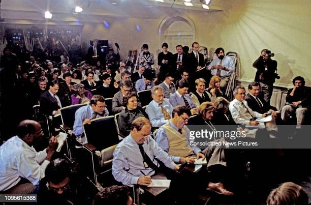 View of journalists in the White House's Press Room, Washington DC, November 13, 1995. Among those visible are, front row from left, Steve Holland ,...