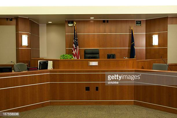 view of judicial bench in modern courtroom setting - courtroom stock pictures, royalty-free photos & images