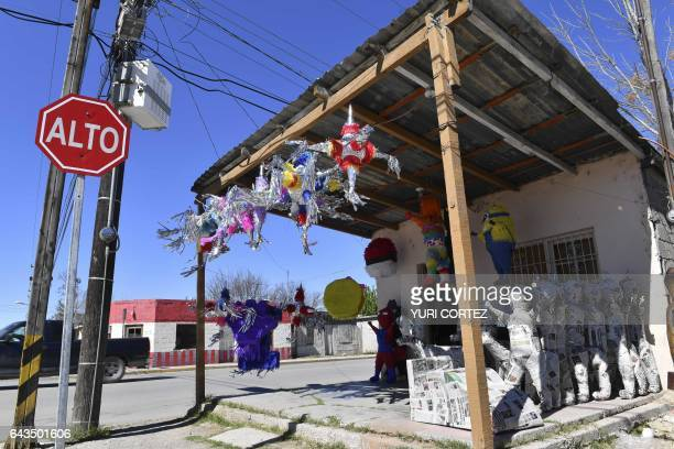 A view of Julia Garcia's pinata store is seen on the US/Mexico border City of Ciudad Acuna on February 21 northern Mexico where several US citizens...
