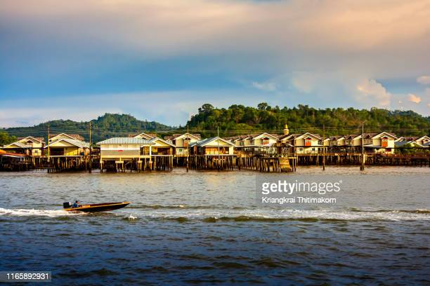 view of kampong ayer or water village, brunei. - brunei stock pictures, royalty-free photos & images
