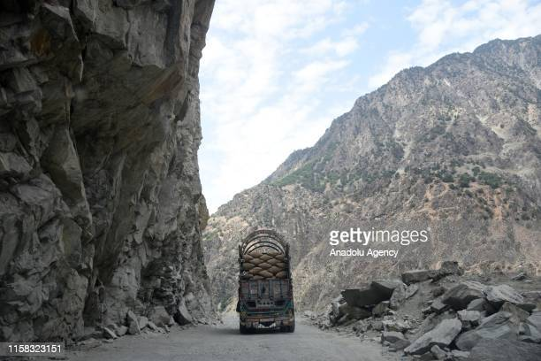 A view of Karakorum Highway located on Silk Road is seen on the Karimabad Region where a number of summits meet and host historical Baltit Fort also...