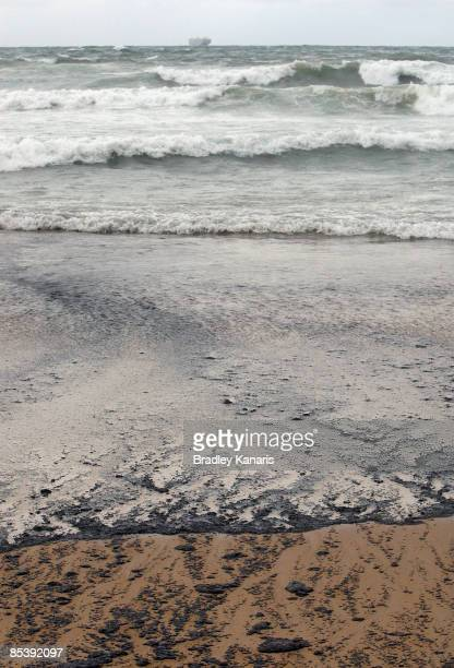 A view of Kawana Beach is seen after an oil slick which escaped from the container ship 'Pacific Adventurer' during this week's Cyclone Hamish off...