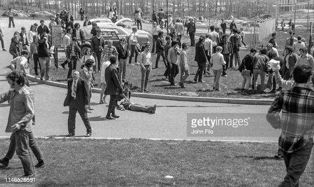 View of Kent State University students around the body of student Jeffrey Miller after he'd been shot when the Ohio National Guard opened fire on...