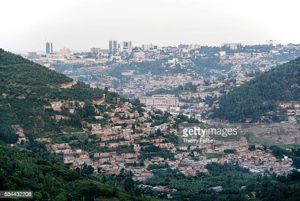 View of Kigali on the road from the west. Kigali, with a population of more than one million, is Rwandas capital and main city. The city is built on...