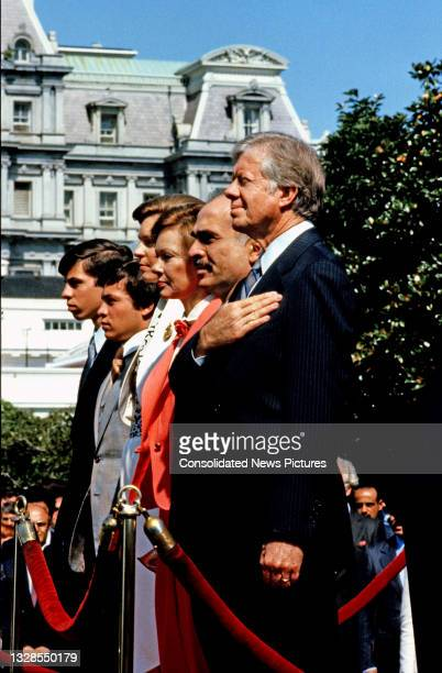 View of King Hussein I of Jordan and US President Jimmy Carter as they stand for their respective national anthems during a State Arrival ceremony on...