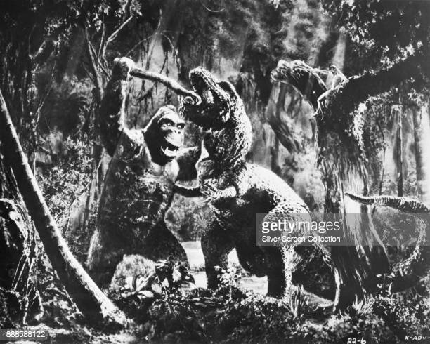View of King Kong battling a Tyrannosaurus in a scene from 'King Kong' 1933
