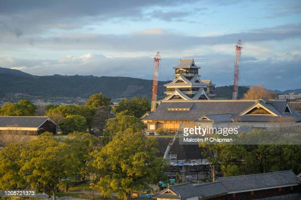 view of kumamoto castle showing cranes and construction work following the 2016 earthquake, kumamoto, kyushu, japan - kumamoto prefecture stock pictures, royalty-free photos & images