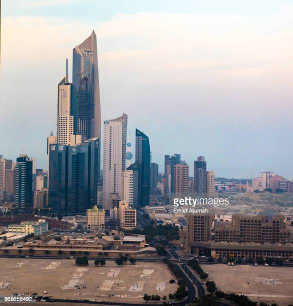 view of kuwait city at sunset - kuwait city stock photos and pictures