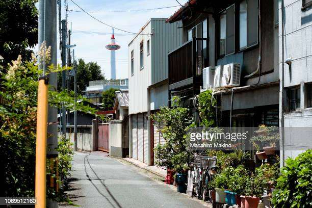 view of kyoto tower from an alley - 住宅地 ストックフォトと画像