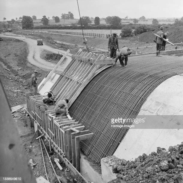 View of Laing workers constructing Structure 75 on the London to Yorkshire Motorway , a bridge carrying the motorway over the A43, showing shuttering...