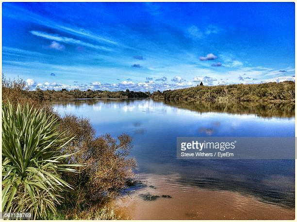 view of lake against cloudy sky - hamilton new zealand stock photos and pictures