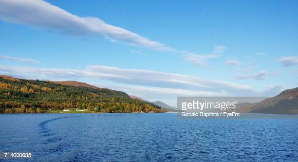 view of lake against cloudy sky - loch ness stock photos and pictures