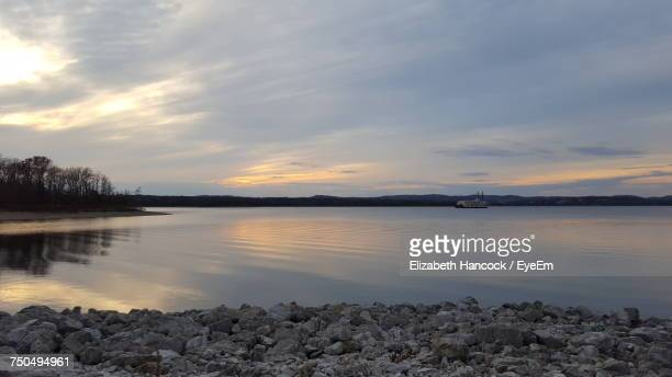 view of lake against cloudy sky - branson missouri stock pictures, royalty-free photos & images