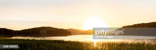 view of lake at sunset - västra götaland county stock pictures, royalty-free photos & images