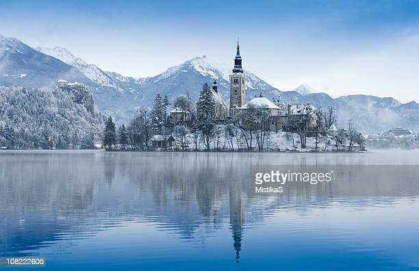 view of lake bled in the winter - slovenia stock pictures, royalty-free photos & images