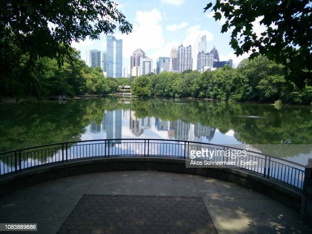 view of lake by buildings against sky - atlanta bildbanksfoton och bilder