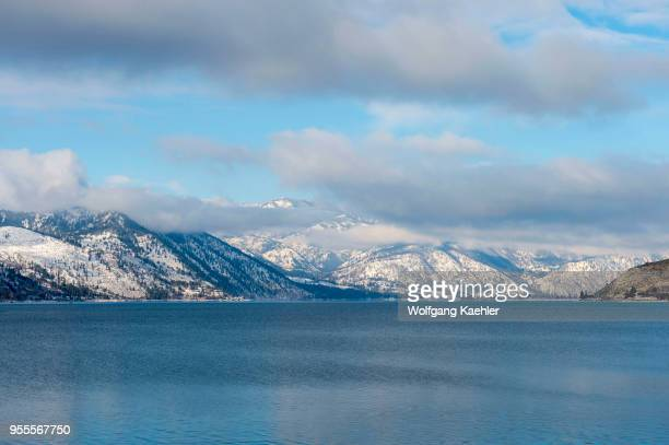 View of Lake Chelan in Eastern Washington USA with snow covered mountains in winter
